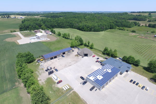 Solar panels on office and garage rooftops