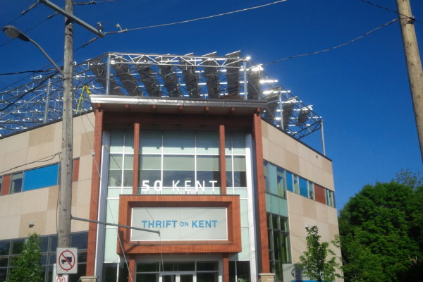 Solar panels on building rooftop from ground