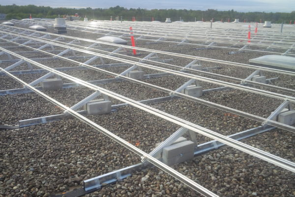 Solar panel racking on gravel roof