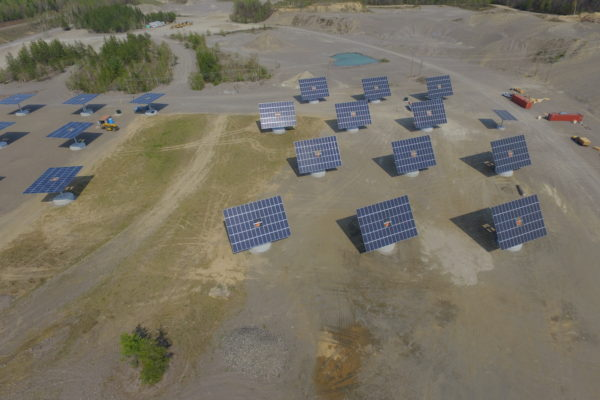 Solar trackers in a gravel pit