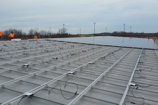 Laying solar panels on a metal roof