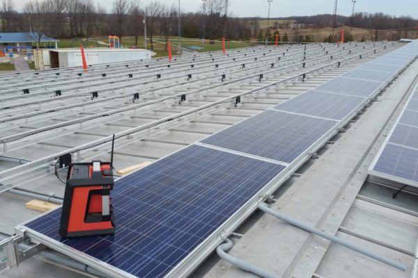 Solar panels and racking on a pitched metal roof